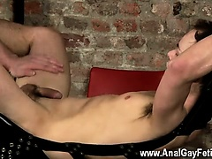 Hot twink scene Hanging there trussed to the sling he has no