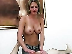 Her tits out as she strokes big cock