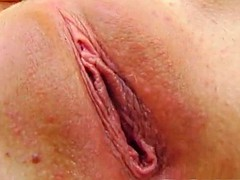 horny brunette penetrates her tight pink pussy with a dildo
