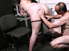 Plumper in fishnet rides cock boss