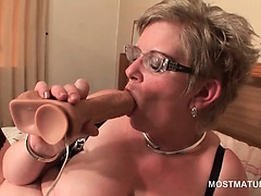 Mature in stockings toy fucking her wet cunt