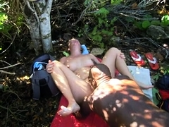 Lustful white babe has a black guy licking her cunt outside