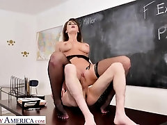 Emily is dressed in nothing but dark-hued pantyhose while ravaging her college girl Juan, in the classroom