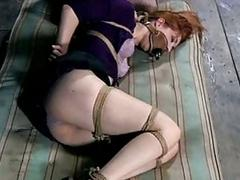 Sexy redhead woman roped and humiliated in sex dungeon BDSM