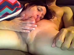 Enticing mature wife delivers a sensual blowjob on webcam