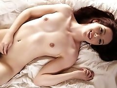 Hairy redhead Ember Stone sits on a thick dick