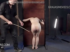 Skinny girl with small titties gets her butt caned hard