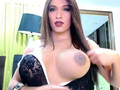 Buxom shemale flaunts her splendid curves and her hard shaft