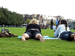 Street voyeur films a blonde and a brunette in the park