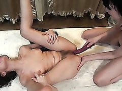 Dildo slips into a hairy cunt in close up