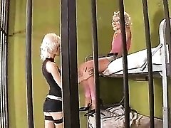 Blonde prison sluts have anal sex with a guard