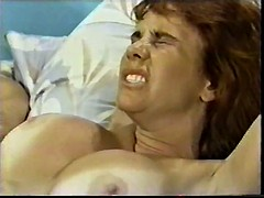 Redhead with big tits sucks and rides cowgirl