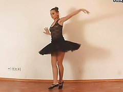 Hot flexible ballerina strips and stretches on photo shoot