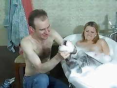 Chubby blonde in pantyhose gets nailed doggy style in bathroom