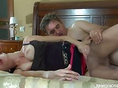 Short haired brunette in pantyhose gets pounded doggy style in bedroom