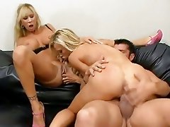 Girlfriends Amberlina Lynn and Morgan Ray enjoys a threesome fuck on the couch