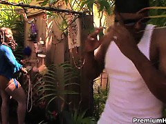 Big ebony mom Anjel Devine sunbathing on her backyard and